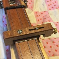 New Ron Ewing Custom Capo (Curly Koa).jpg