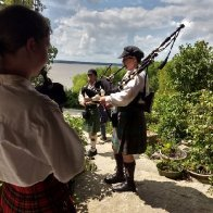 Bag pipers on the porch