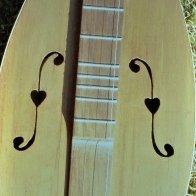 heart-embellished f-holes Romey Pittman.jpg