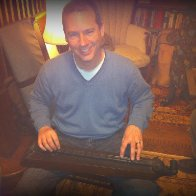 Me playing a mid-1800s dulcimer