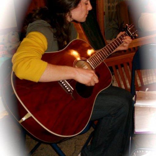 Singing, strumming, visiting Sarah