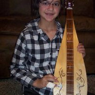 Sheila with the dulcimer she built this past year.