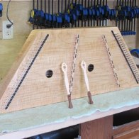 Strung dulcimer and hammers