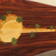 A close-up of the banjo and ivy inlay.